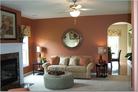 Orange peach living room walls thenest for Model living room ideas