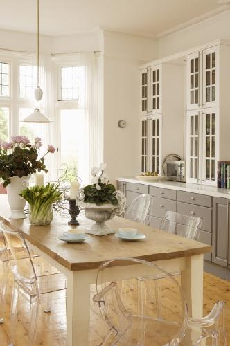 dining rooms - gray kitchen cabinets white glass-front cabinets farmhouse dining table glass pendants white drapes  Thanks to living Etc.