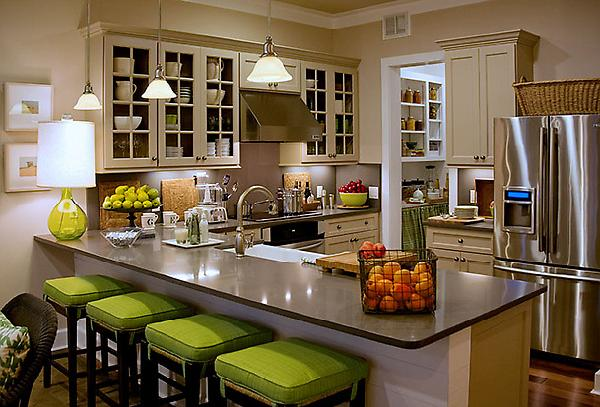 Luxury kitchen interior with island and stylish green stools