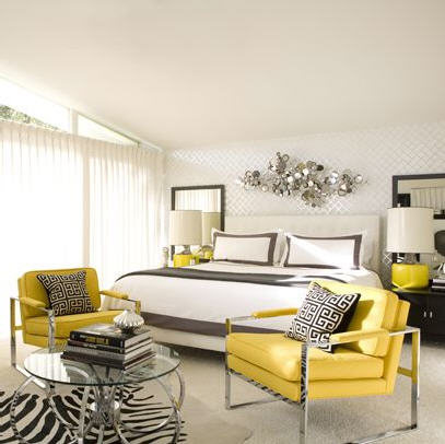 bedrooms - yellow  gray  black  white  upholstered  headboard  bed  bright  yellow  modern  chrome  chairs  glass  top  chrome  modern  coffee table  black  nightstands  yellow  lamps  silver  abstract  wall art  white walls  white  bedding  gray  ribbon  border  trim  black  white Greek key  Jonathan Adler  pillows  cowhide  zebra rug  gray  rug  modern  bedroom