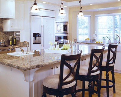 Gorgeous kitchen with white cabinets and granite countertops counter tops! Love the small glass pendant lighting and x dark wood stools in this space