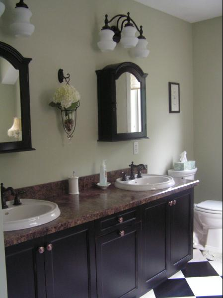 Inexpensive bathroom makeover. Cabinet doors and countertop replaced