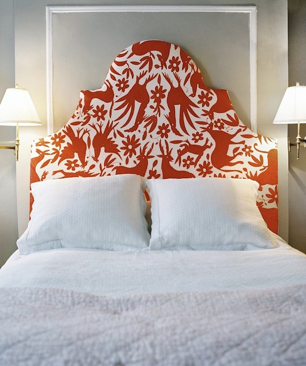 bedrooms - gray white red upholstered headboard brass sconces white molding white bedding gray throw blanket gray walls paint color modern fun bedroom