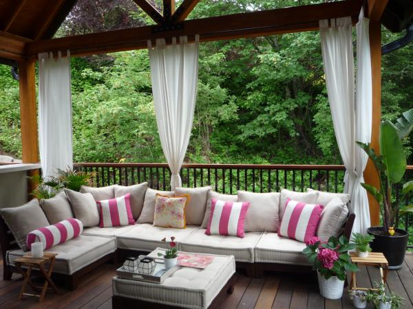 decks/patios - outdoor sectional exterior curtains  Outdoor living space  white and pink striped pillows and outdoor furniture.
