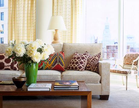 living rooms - cushions green vase walnut coffee table yellow drapes yellow gourd lamp  neutral couch, printed cushions, colour!  Oatmeal modern