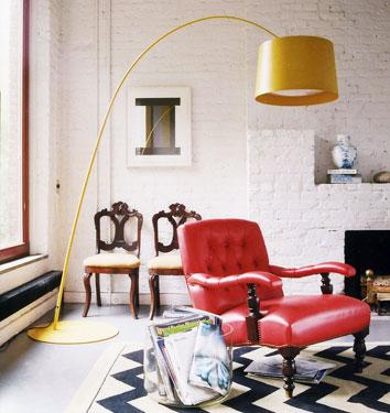 living rooms - chevron rug yellow arc lamp red tufted chair chevron navy rug fireplace  eclectic living space  yellow arc lamp, red tufted chair,