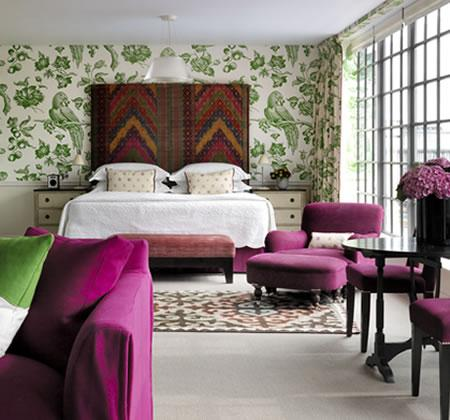 bedrooms - green wallpaper headboard bed rug green fuchsia chair white nightstands bench  Beautiful. From Firmdale Hotels.  Green wallpaper,