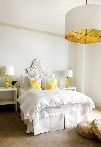 bedrooms - large white pendant light gold lining white tufted headboard white bedding white yellow hummingbird throw pillows white modern nightstands yellow lamps seagrass cushions