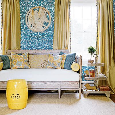 living rooms - yellow garden stool yellow silk drapes settee blue damask wallpaper step table yellow blue living room  house of turquoise   yellow