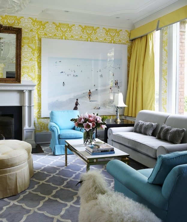 living rooms - turquoise chairs gray Moroccan tiles rug gray sofa fireplace yellow wallpaper yellow silk drapes blue gray yellow living room