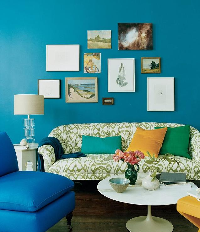 Design contemporary living room with blue walls and green motif sofa