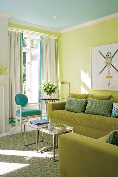 living rooms - turquoise French chair gray yellow geometric rug chrome accent tables green velvet sofa chair green walls turquoise blue ceiling fireplace white drapes blue green fabric trim