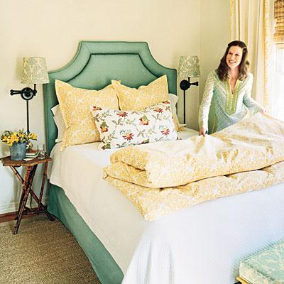 bedrooms - Heather Chadduck seafoam green headboard bed yellow pillows duvet sconces sisal rug  Bright Guest Room  Blue green headboard withnailhead