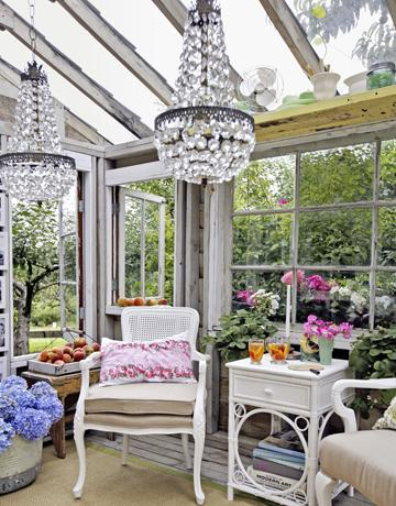 gardens - outdoor sitting area hothouse green house white wicker furniture crystal chandelier  outdoor sitting area  gorgeous, whimsical hothouse