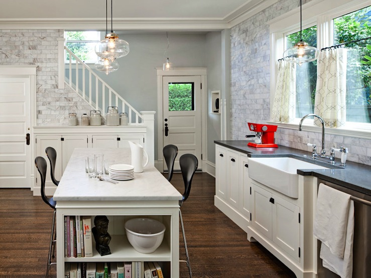 kitchens - Benjamin Moore - Mascarpone - White Carrara Marble Subway Tiles creamy white cabinets apron sink chrome fixtures black countertops kitchen island marble island countertops black stools white carrara marble tiles backsplash glass light pendants kitchen