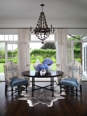 Gina Kates: white, black and blue dining room  blue and white wingback chairs, white & black zebra ...