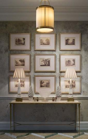 entrances/foyers - brass marble French console table brass pendant alabaster lamps art gallery  Phoebe Howard.  Gorgeous elegant foyer design