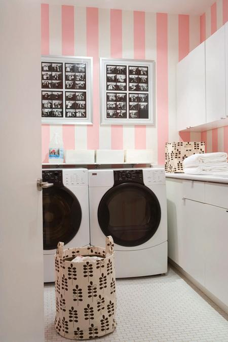 laundry/mud rooms - black white photography art vertical striped stripes pink walls white washer dryer white cabinets white pink laundry room
