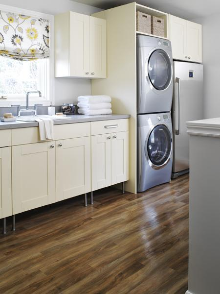laundry/mud rooms - ivory cream cabinets gray countertop gray walls paint color white yellow gray floral roman shade wood floors laundry room