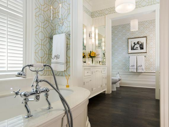 bathrooms - Brewster Heather Geometric Wallpaper blue green geometric wallpaper tub chrome fixtures espresso stained wood floors white bathroom vanity mirrors chrome sconces drum pendant lights