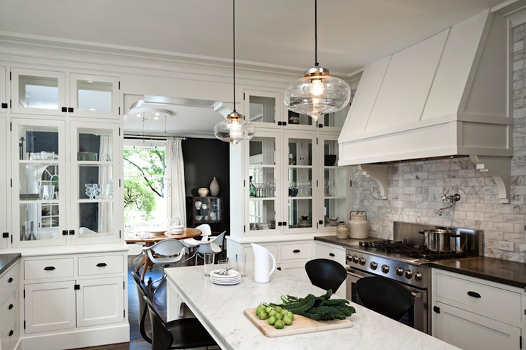 kitchens - Pot Filler White Carrara Marble Subway Tiles black Cherner barstools counter stools backsplash glass lantern pendants marble countertops white glass-front kitchen cabinets