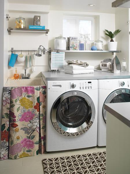 laundry/mud rooms - brown rug pink yellow floral sink skirt stainless steel floating shelf white washer dryer  Mark Burstyn Photography via House
