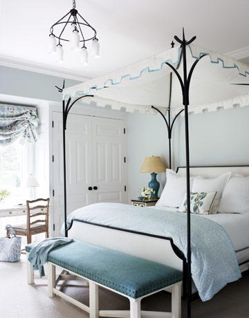 bedrooms - Benjamin Moore Pearl Gray - Hickory blue bench nailhead trim black iron Oscar De La Renta canopy bed turquoise blue lamp linen lamp shade blue gray walls paint color roman shade chandelier