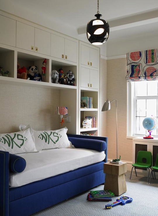 boy's rooms - royal blue velvet daybed day bed white built-ins cabinets shelves modern pendant chrome floor lamp blue rug green chairs white red green blue roman shades