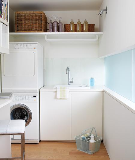 laundry/mud rooms - white cabinets white washer dryer wicker baskets blue walls paint color laundry room  William MacDonald Interiors.   Modern