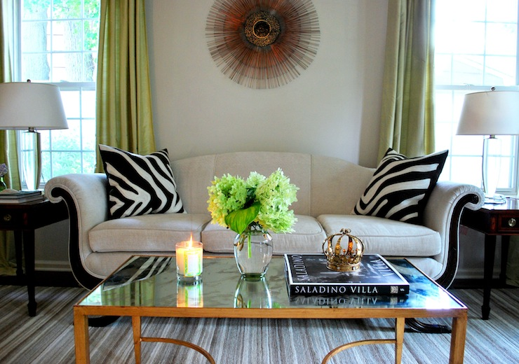 Dwell And Tell Sunburst Mirror Behind The Sofa