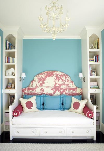 girl's rooms - turquoise blue accent wall white chandelier red toile upholstered fabric headboard built-in day bed blue pillows fuchsia pink bolster pillows silhouette pillows sconces drawers