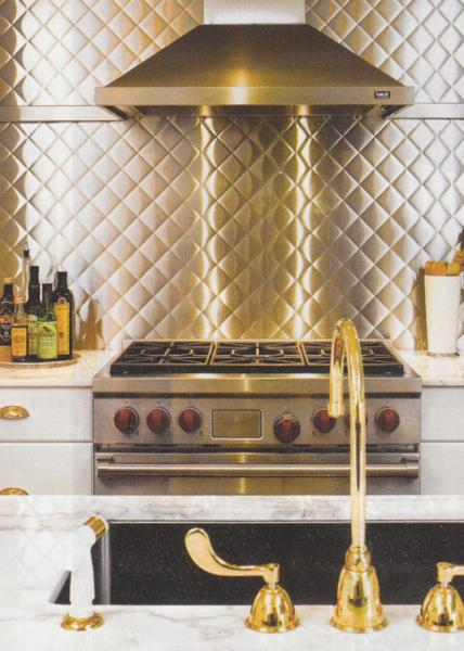 kitchens - stainless steel backsplash white kitchen cabinets gold faucet hardware white carrara marble countertops  Robert Brantley via Traditional