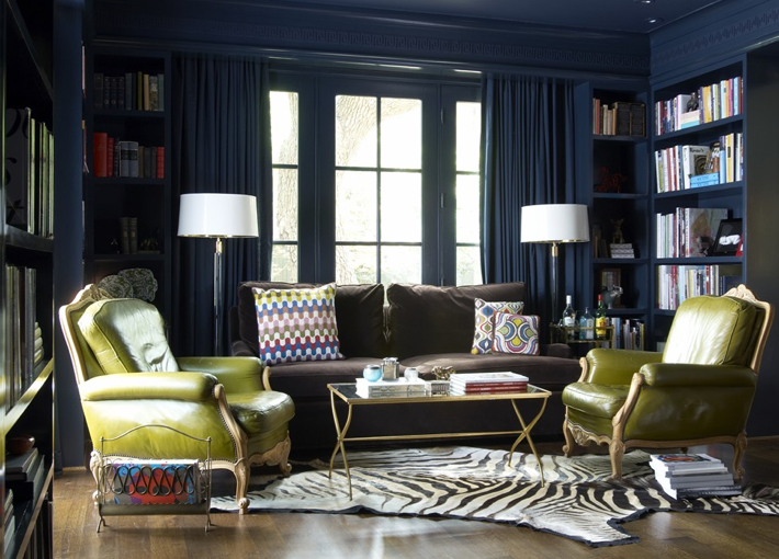 Design contemporary living room with blue walls and blue bookcase