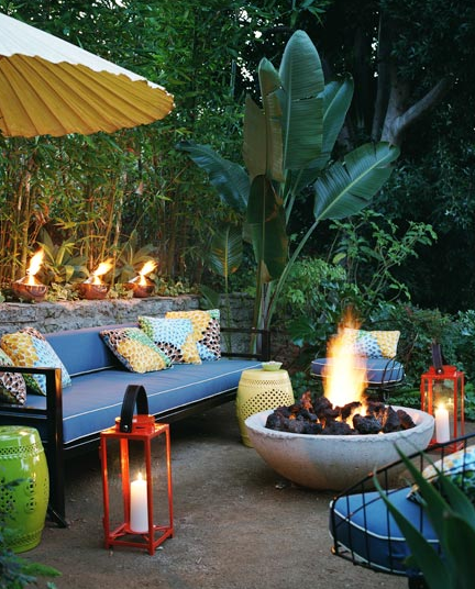 decks/patios - yellow lime green garden stools outdoor sofas blue cushions red hurricane lanterns fire pit  David Tsay Photography.  Colorful