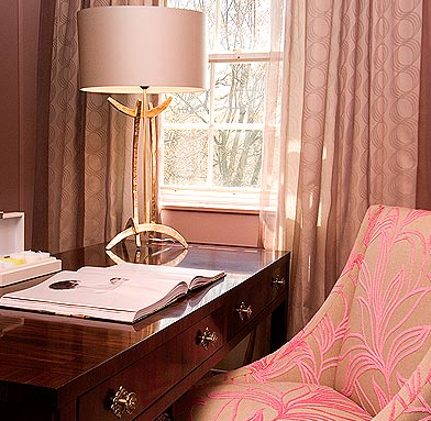 dens/libraries/offices - brass lamp desk pink gray chair silk drapes gray walls  Evelyn Chin Interior Design.  pink & gray office design with
