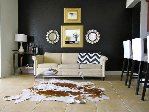 lynett perez:  living room. black walls living room, lucite table, vintage bar cart, ikea barstools, ...