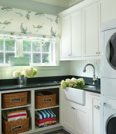laundry/mud rooms - farmhouse sink white cabinets black countertops baskets white washer dryer roman shade white blue laundry room  Ken Gemes
