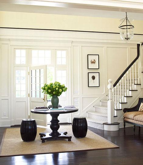 entrances/foyers - black garden stools black pedestal table sisal rug art  Ken Gemes Interiors & Tria Giovan Photography!  beautiful transitional
