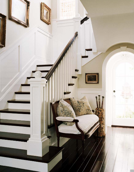 entrances/foyers - glossy ebony floors bench wainscoting staircase gold gilt vintage frames art tan gray walls  Joe Schmelzer Photography!  gorgeous