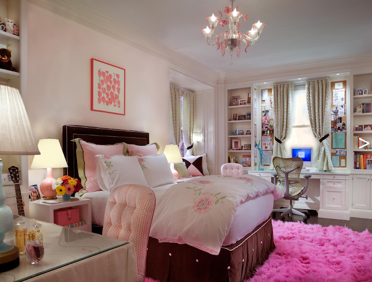girl's rooms - pink walls chocolate brown velvet headboard pink piping brown bed skirt pink green duvet pillows bedding white nightstands pink lamps built-ins desk shelves pink shag rug pink crystal chandelier