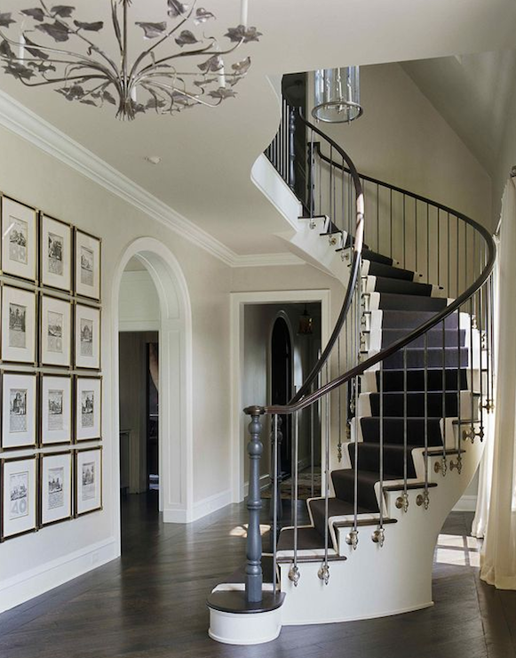 entrances/foyers - grand luxurious curved staircase white black staircase art gallery arched doorway pendant chandelier  Sherrill Canet  grand