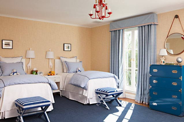 boy's rooms - Jonathan Adler Giraffe Sconce glossy blue chest blue cornice box drapes sand beige grasscloth wallpaper white twin headboards blue bedding white blue striped x bench stools red faux bamboo chandelier