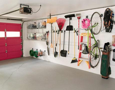garages - hot pink garage door Gladiator GarageWorks's GearTrack Channels  Annie Selke's garage  House Beautiful  Hot pink interior garage door