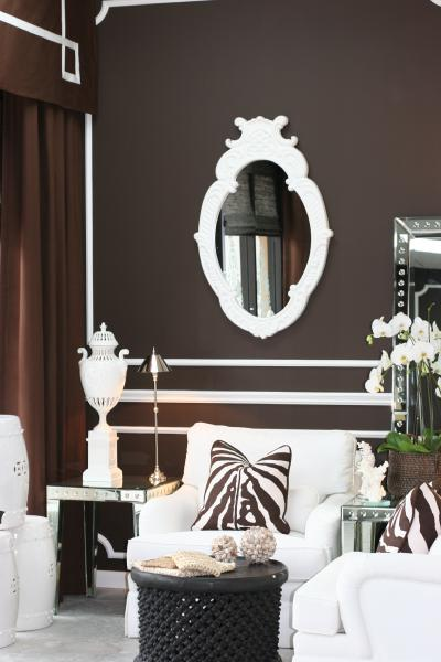 living rooms - Brown white mirror applied molding zebra african stool urn grosgrain curtain Terri Pakravan  Designed by Terri Pakravan   Chocolate