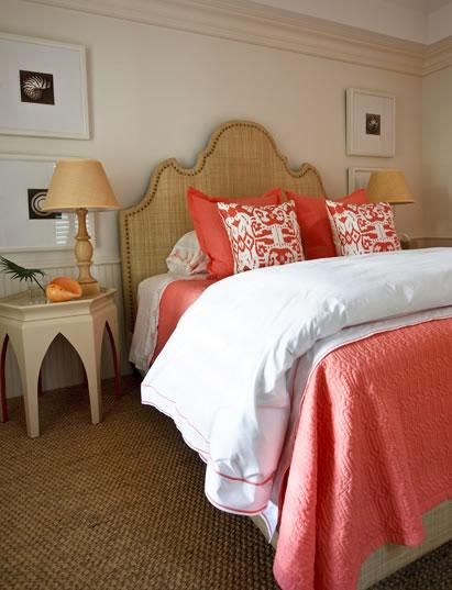 bedrooms - burlap headboard bed nailhead trim tan lamps tan Moroccan tables nightstands orange pink persimmon duvet pillows  Phoebe Howard.