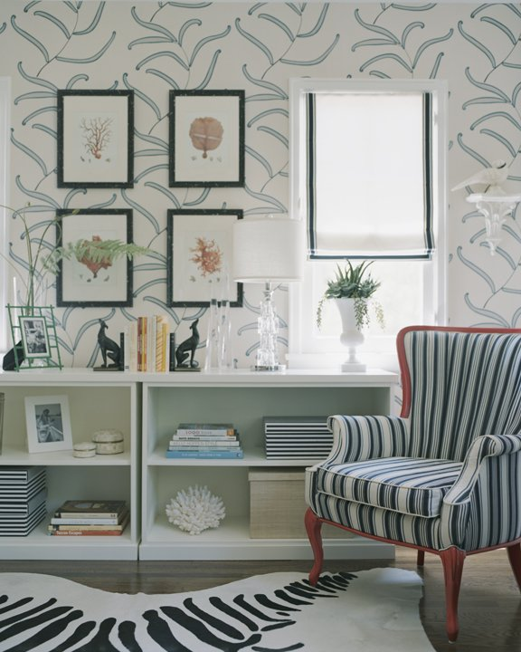 dens/libraries/offices - blue lattice wallpaper red chair white blue striped fabric zebra cowhide rug white bookcases  Erinn Valencich.  gray
