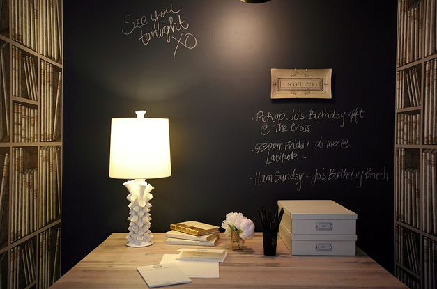 dens/libraries/offices - black chalkboard accent wall white lamp faux library bookshelves wallpaper  The Cross Design & Decor via bazaarofserendipity.blogspot.com