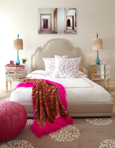 girl's rooms - tan bed headboard mirrored nightstands turquoise blue lamps purple ikat cushions pillows beige Madeline Weinrib medallion rug pink leather pouf red throw