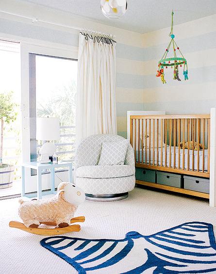 nurseries - Jonathan Adler Zebra Rug modern crib white blue painted horizontal striped rug blue trellis swivel chair white silk drapes blue table turquoise blue mobile