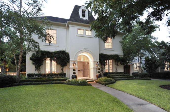 Suzie: via COTE DE TEXAS  Gorgeous home exterior with gray shingles and black lanterns sconces.